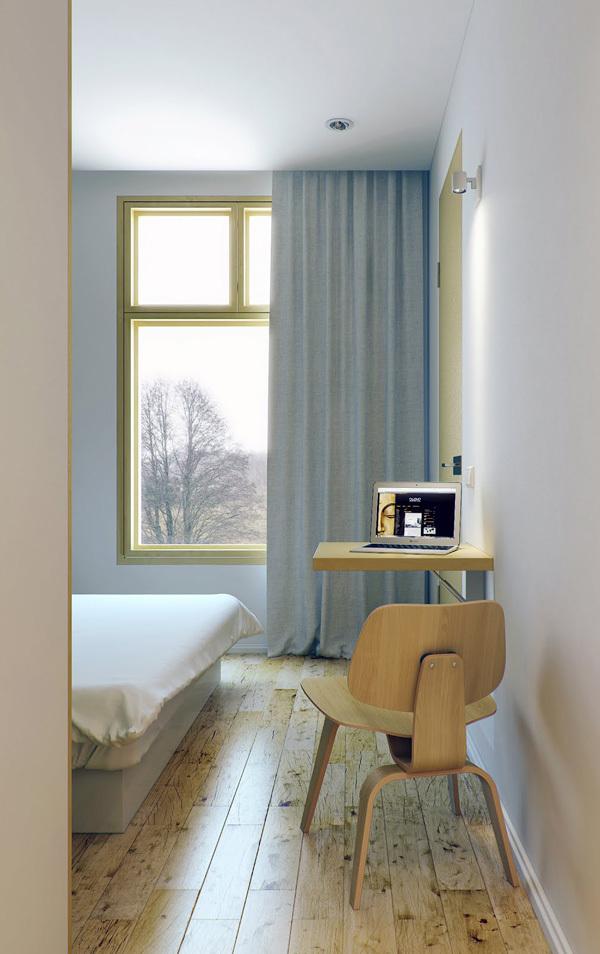 这个小公寓的室内设计大多只有使用轻木和白色油漆,十分简约.