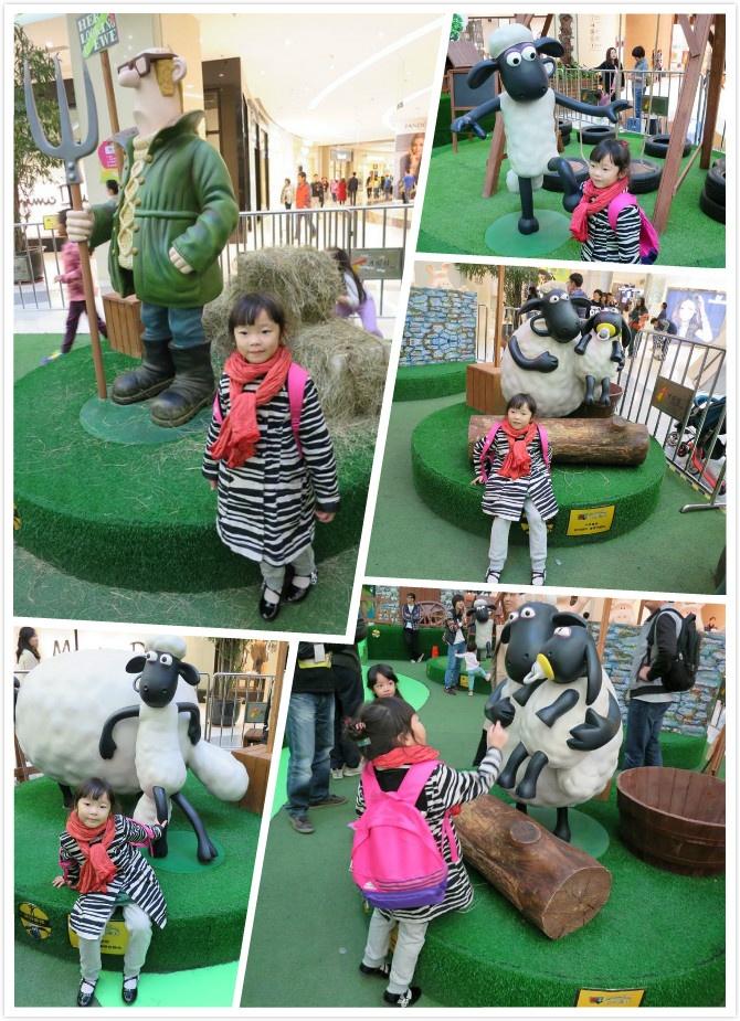 送给腊一一只毛绒可爱的小羊,并与超大号原版呆萌的肖恩合了影.