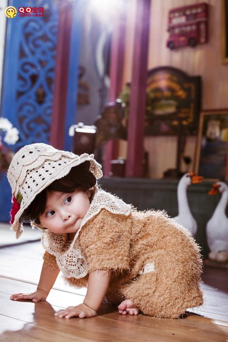 (不哭的宝宝真可爱图片来源:qqbaby儿童摄影)